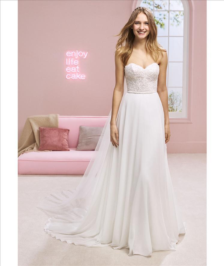 White One Halsey Blush/Ivory  Retail Price $1710 | Our Price $1197