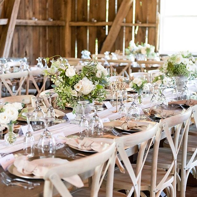 Our favorite way to decorate farm house tables! Lush compote arrangements, bud vases, and finish off with candles and a lovely table runner.  Photographer: @brittanyandersonphoto  Coordinator: @brittanyannesrentals  Rentals: @themustardcouch  Venue: @twintailseventfarm
