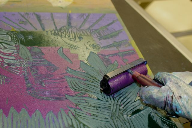 """Ink up your printing plate to prepare for printing your last layer and your chine colle layer. I use small brayers sometimes because I like to """"paint"""" my ink on to the surface of my plate."""