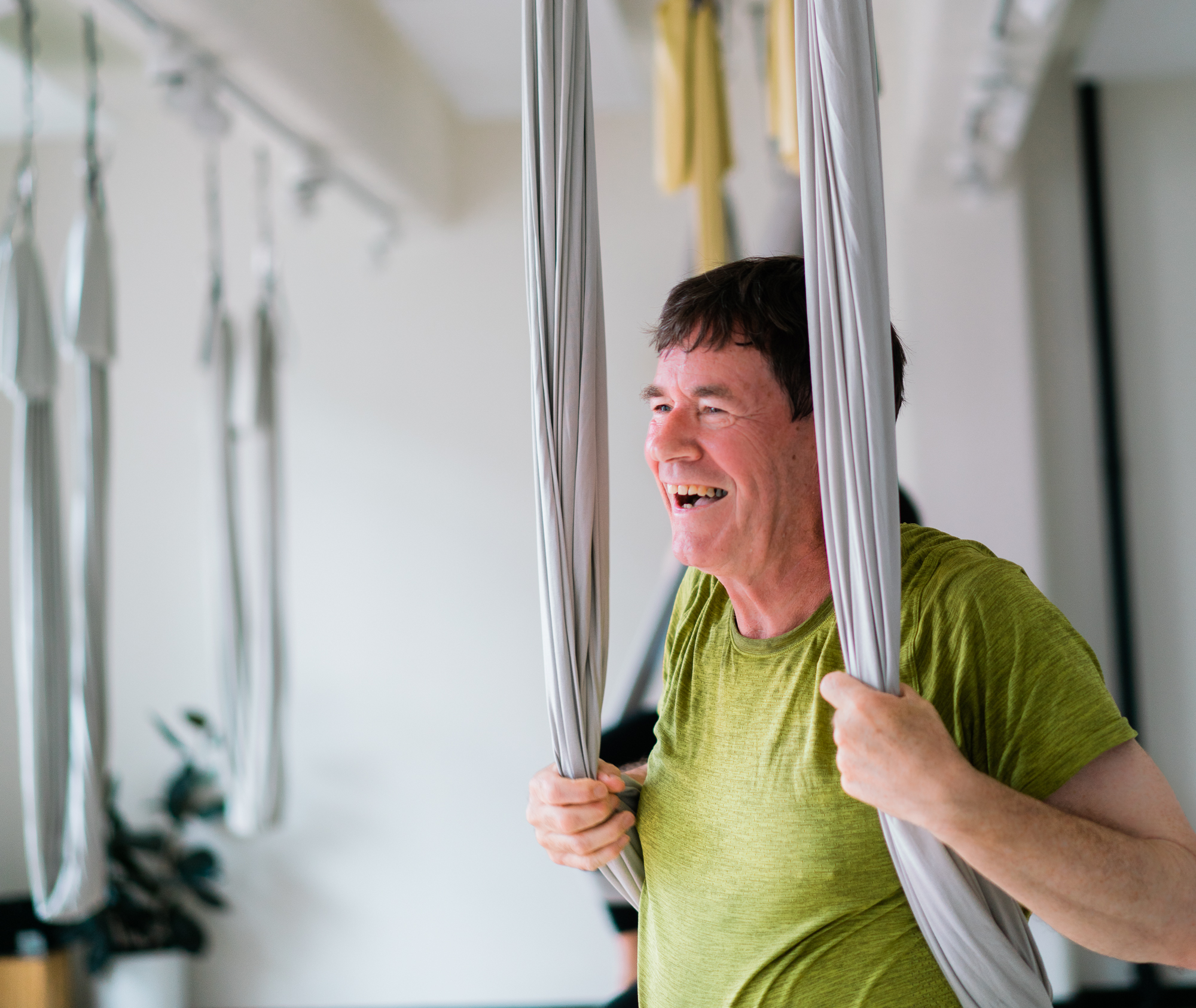 Michael, a dedicated yoga practitioner, in one of his aerial yoga classes at Little Mandarin