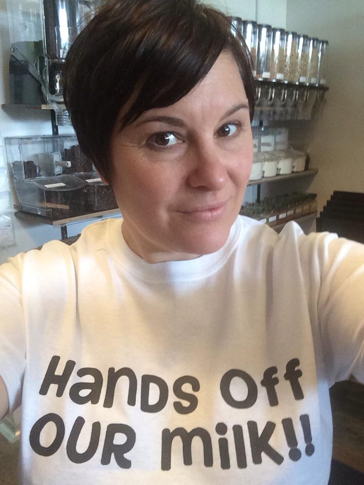 Photo:   Rebecca Freer showing off the t-shirts that's been selling very well