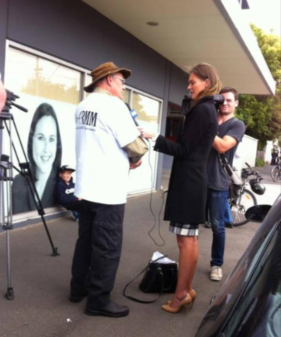 Photo:   Reg Matthews being interviewed in front of minister Jane Garrett's office.