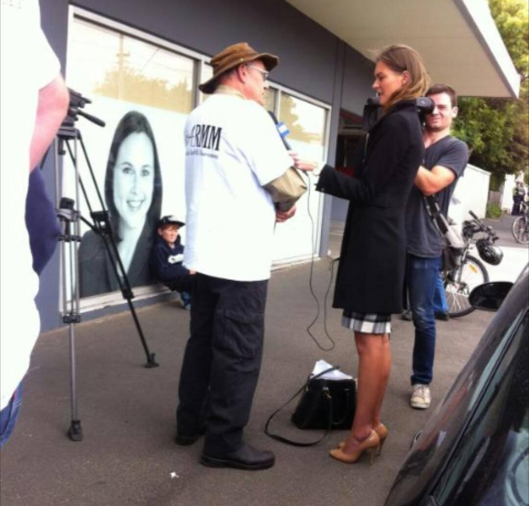 Dairy farmer Reg Matthews interviewed in front of Jane Garrett's office