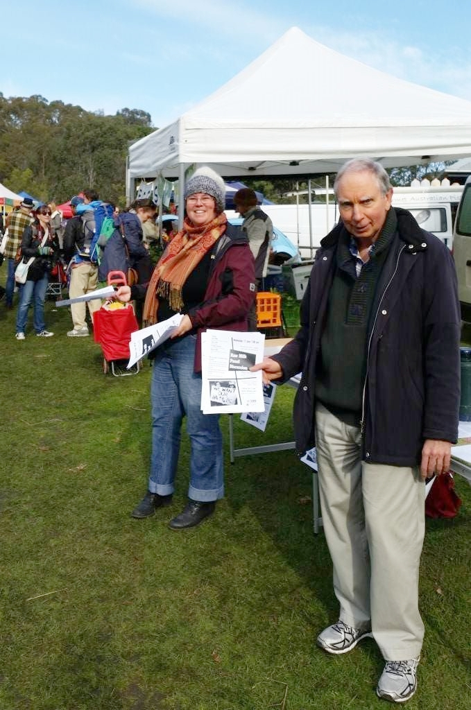 Photo:   Raw milk supporters handing out flyers at a farmers market.
