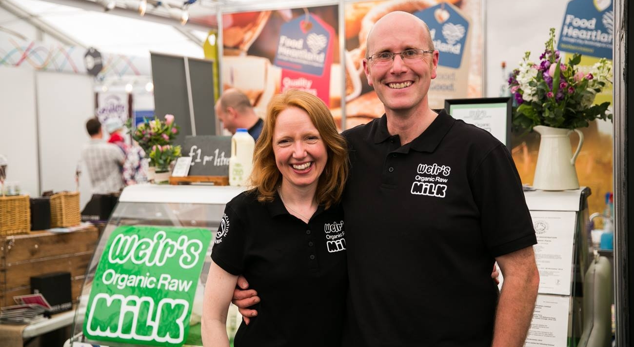 Image:   Weir's Organic Raw Milk was voted Best Food and Drink Product by food writers at the Balmoral show, May 2017 with Deane and Kerrie.