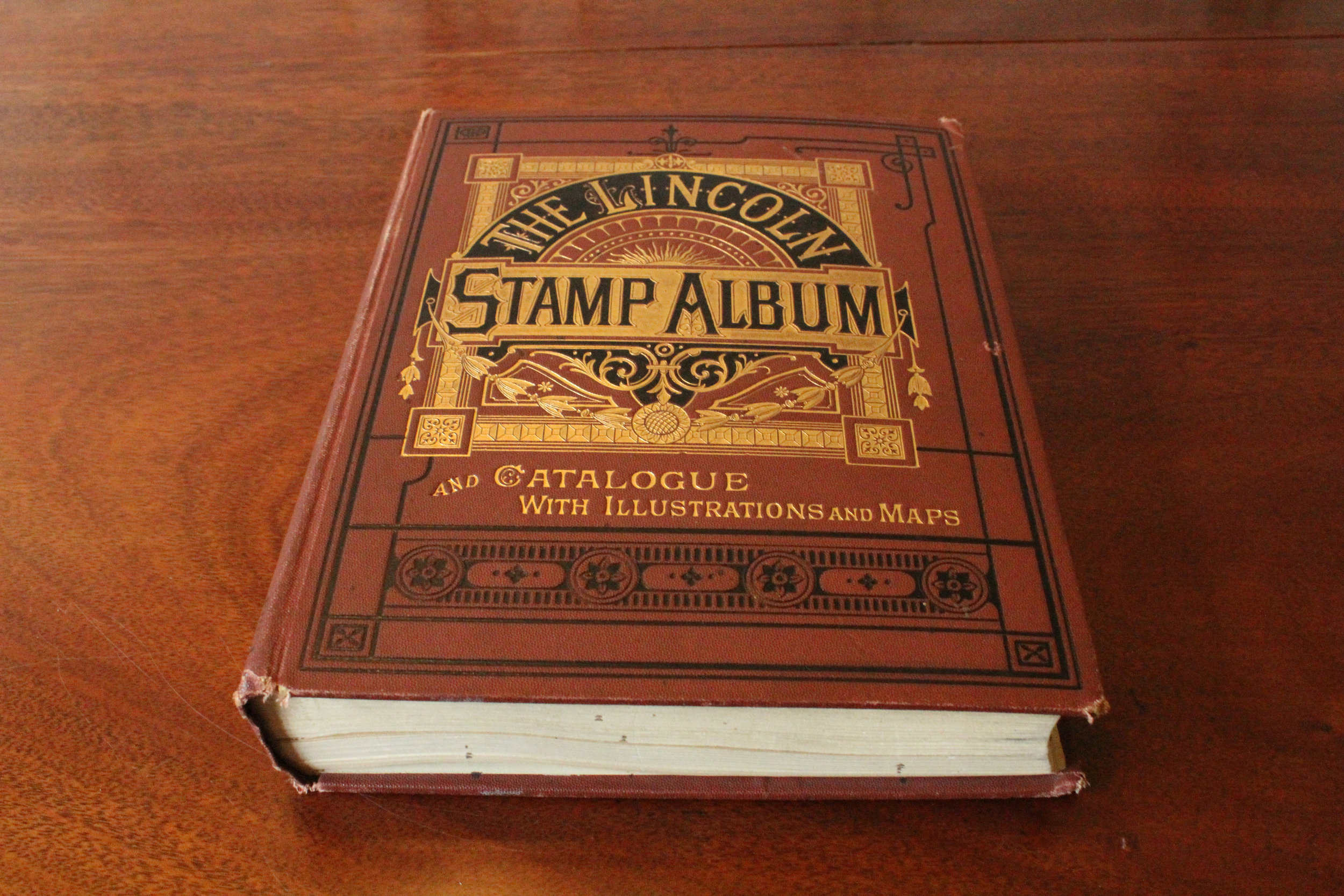 Jack Macdonald's Stamp Collection    Medium adoptable, $100 donation   This book originally belonged to Jack Macdonald, we know this because he had signed his name inside the front cover. Following Jack's death in 1905, Edgar Jordan Tarr (a lawyer at the Macdonald, Haggart, & Whitlaw firm) gifted the book back to the Macdonald family since he did not collect stamps.