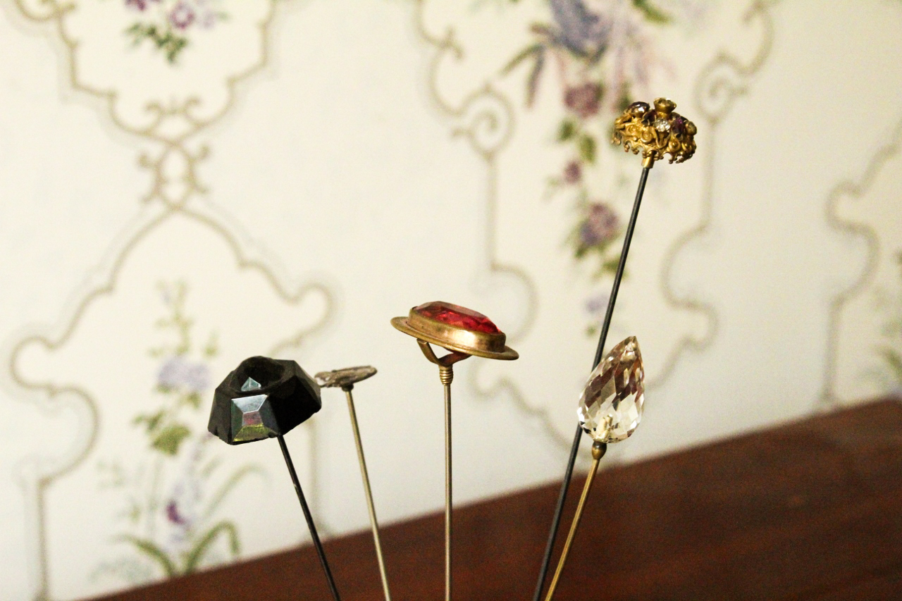 Hatpins    Small adoptable, $50 donation   These decorative hatpins would have been worn by middle to high class women to keep their hair and hats in place. Hatpins often reflected the aesthetic trends of the time (Arts & Crafts; Art Nouveau), and were very popular during the Victorian era. These particular hatpins are made with various jewels, glass, and sterling silver components.