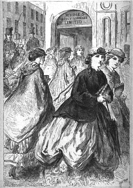 In this 1869 illustration from  London Society , readers clutch their books outside Mudie's Select Library in London.  Wikimedia Commons.