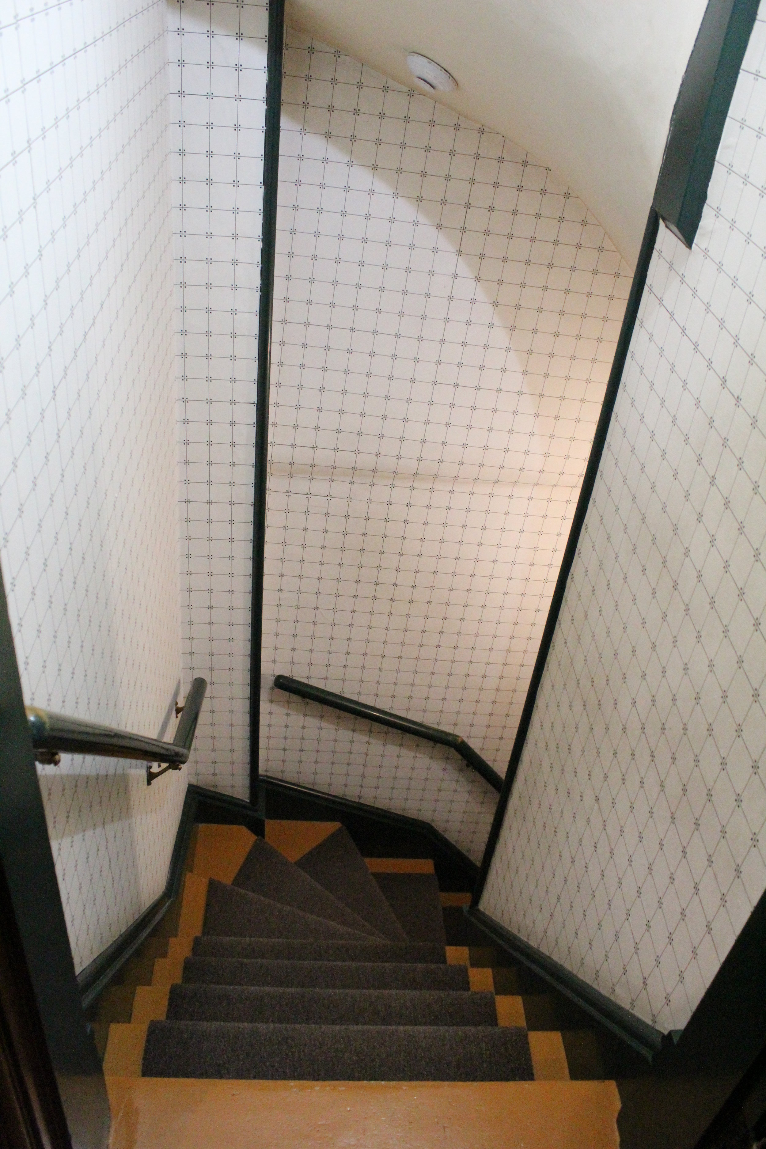 The steep, narrow servants' staircase, leading from the kitchen to the second floor.
