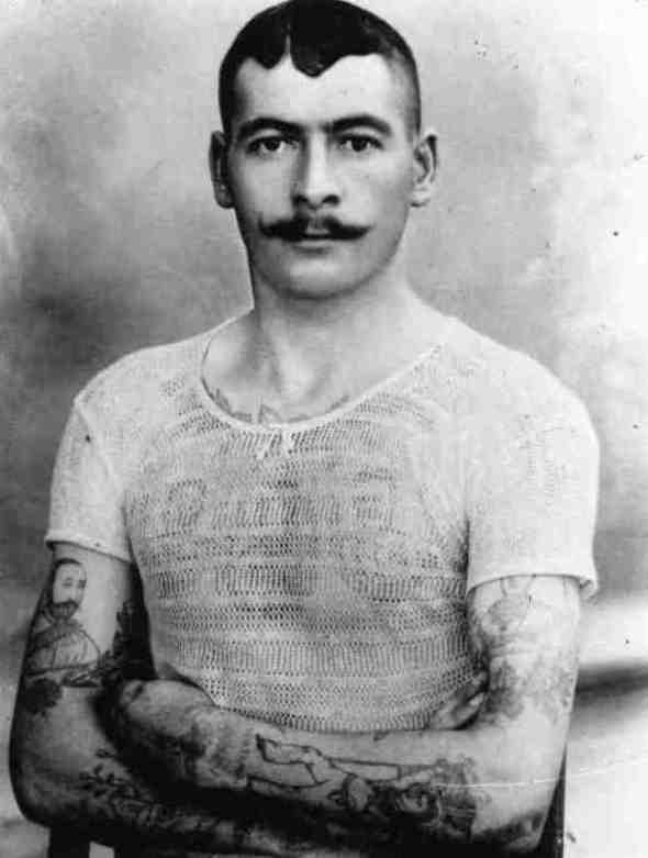Man with several tattoos, circa 1900