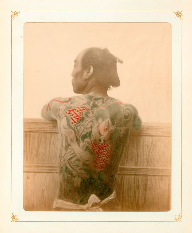 Late 19th-early 20th century image of a man with a Japanese style tattoo.