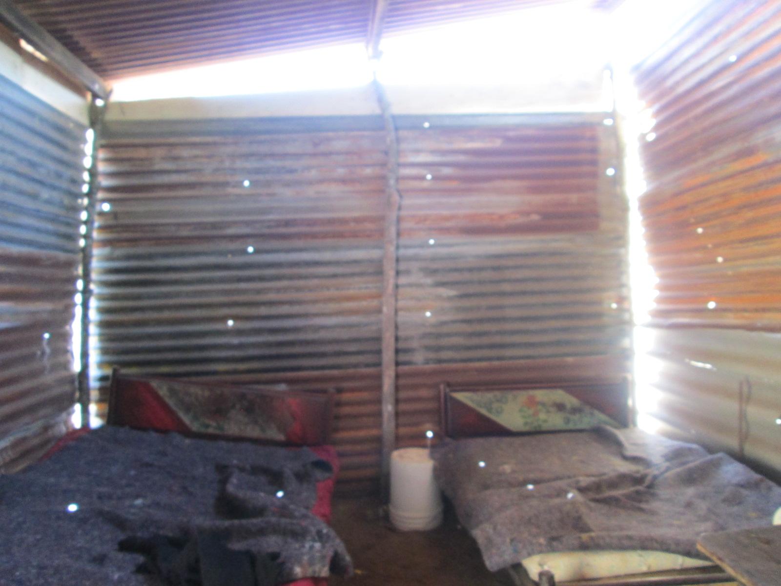Kevins' Former dirt floor shelter