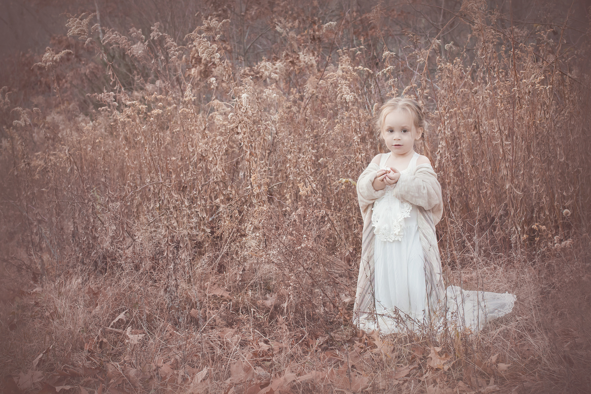 little toddler girl standing in the woods