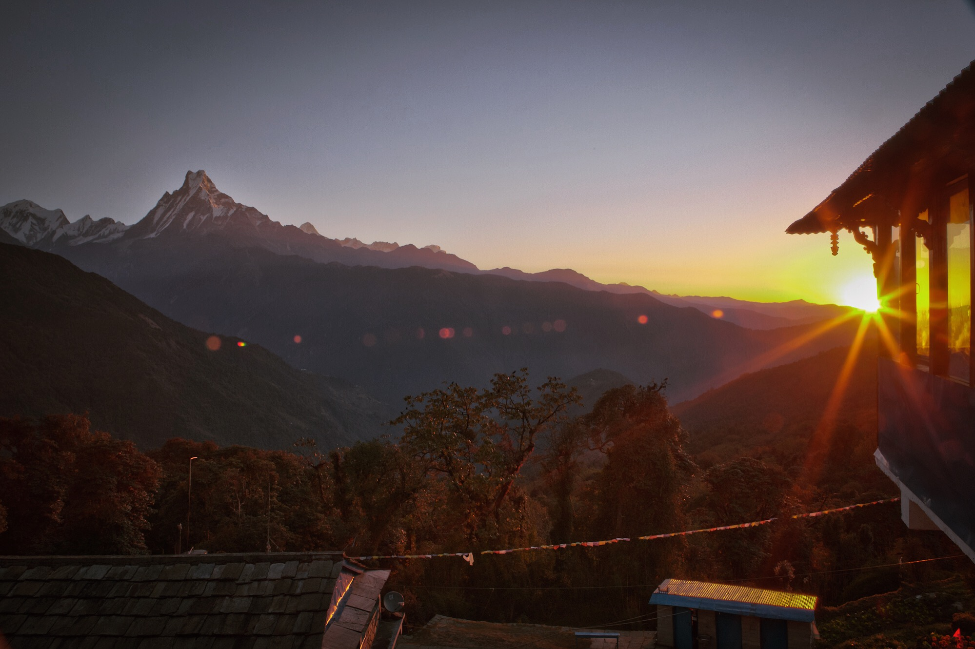 """Nov 10.1, 2016   Tadapani was covered in a cloud when we arrived yesterday. The mountains were a morning surprise. To the left is Machhapuchhre, otherwise known as """"Fish Tail"""", just a few metres short of 7,000. It is revered as a sacred peak, therefore no human has set foot on its summit."""