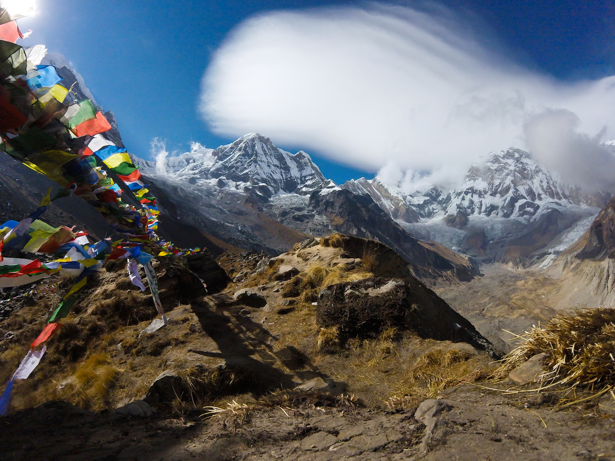 Nov 12.2, 2016   Pictured ahead is Annapurna South, the 101st highest mountain in the world. This place holds an obvious sentiment. Prayer flags fly, cracking in the wind. They are the colors of our elements; of sky, air, fire, water, and earth.