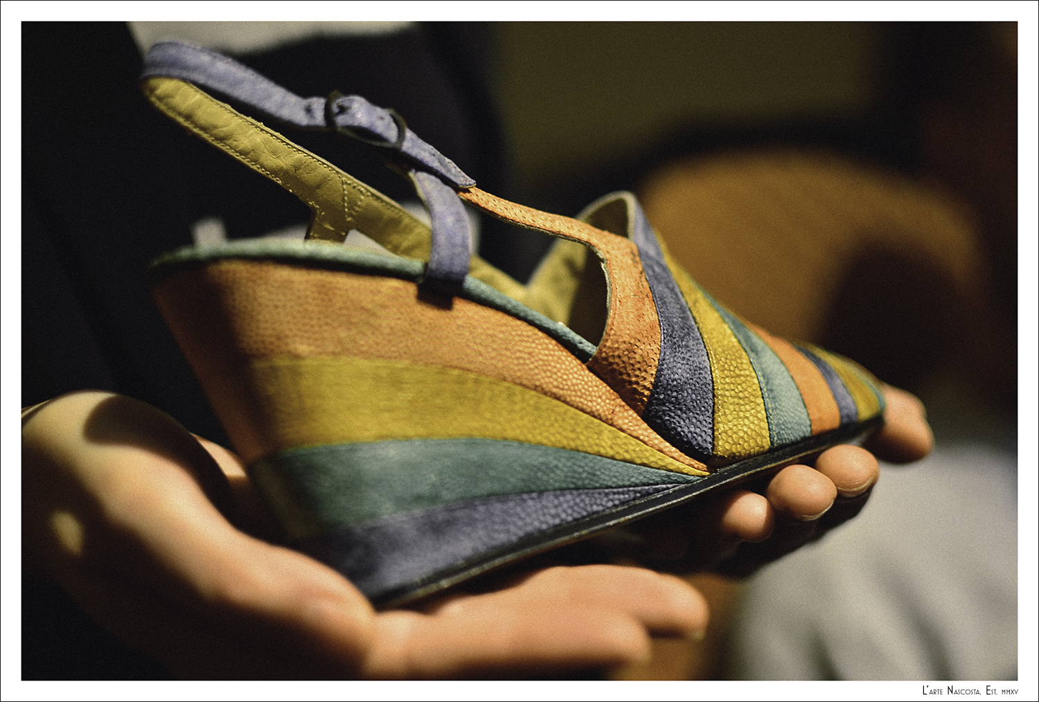 Did you know that Salvatore Ferragamo invented the wedge heal?  This is an example made in fish skin - another Ferragamo innovation.