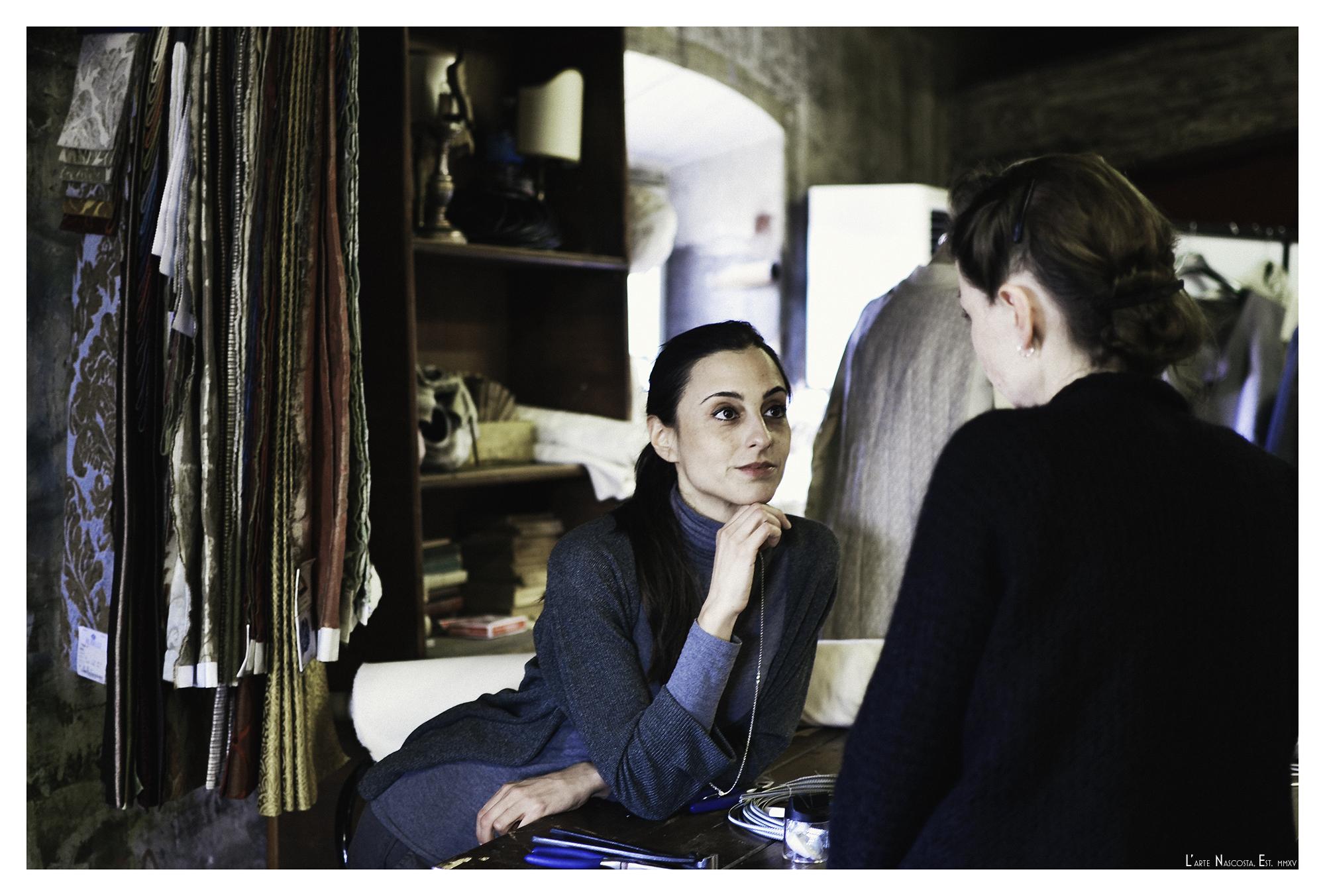 Elena Bianchini consulting with a co-creator in Teatro la Pergola's Set and Costume Design Studio.