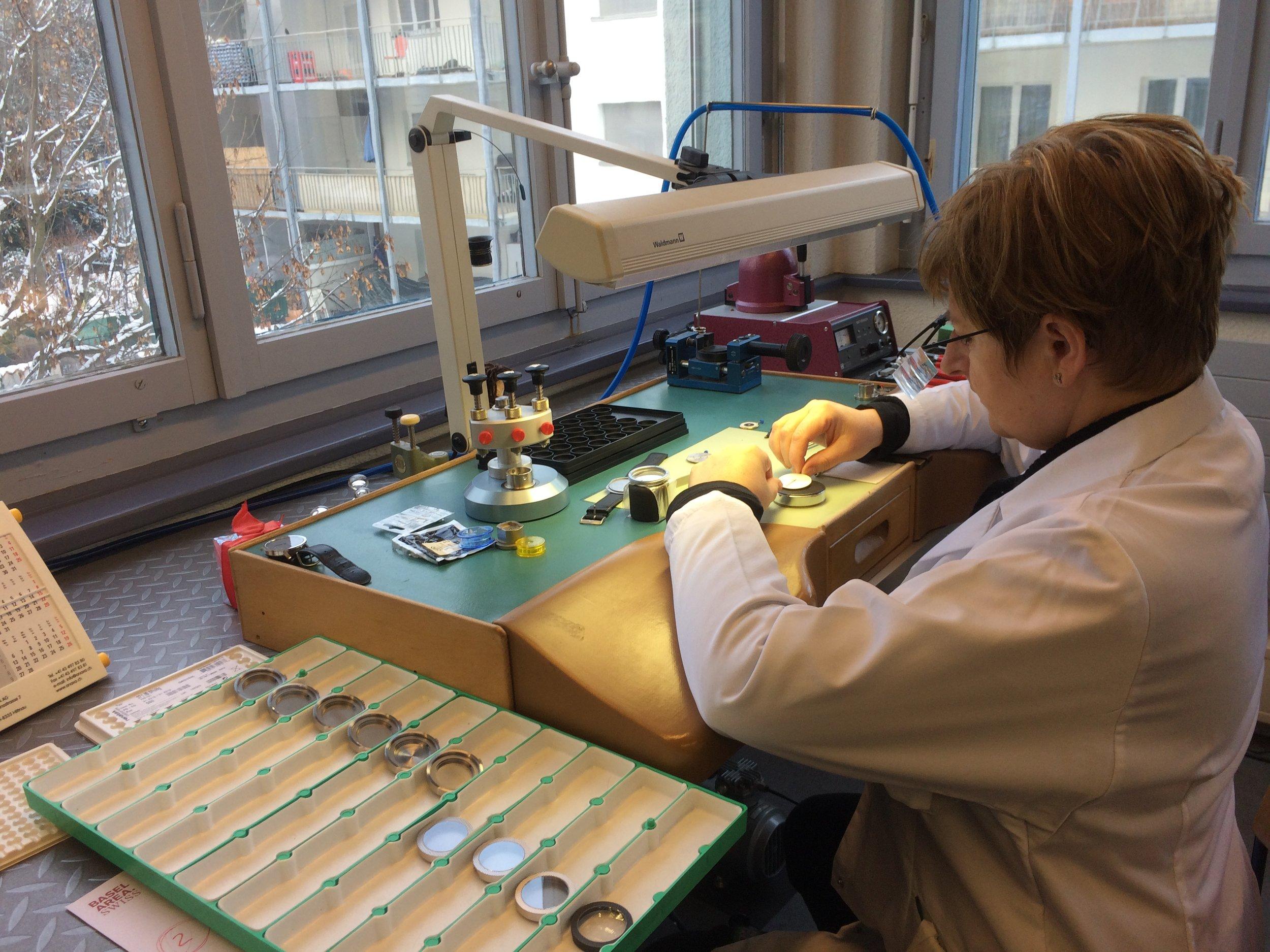 Danuta assembling watches in workshop in Bienne