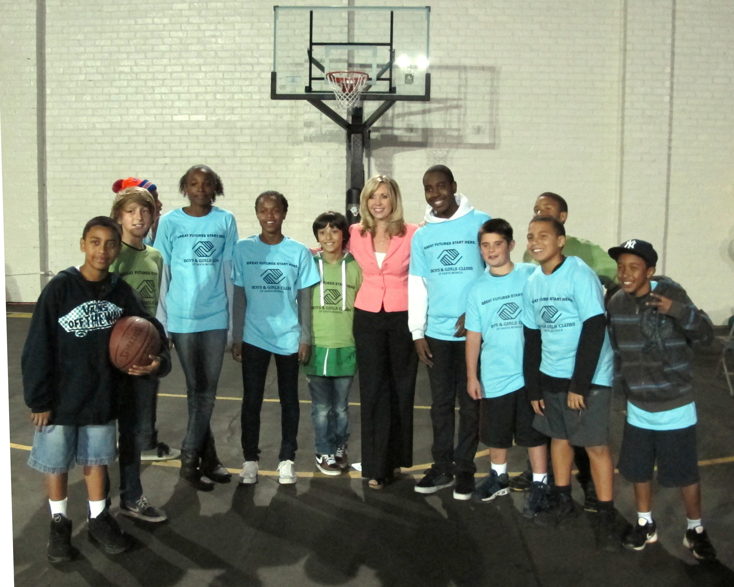 Emceeing unveiling of the new SMBGC sport court made possible by a donation from NBA star LeBron James.