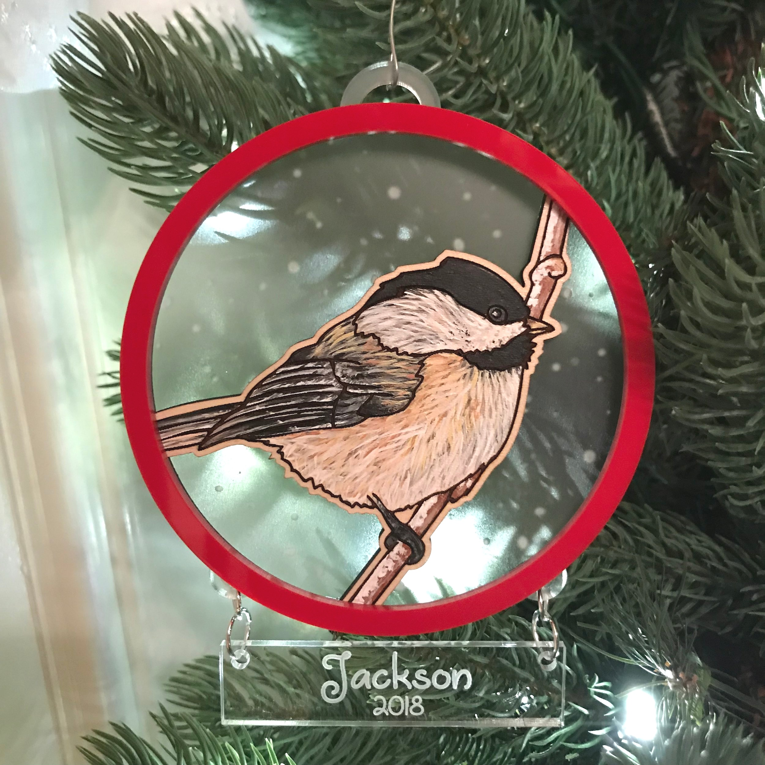 """Chickadee"" custom Christmas ornaments - Acrylic on wood with engraved clear acrylic and red acrylic"