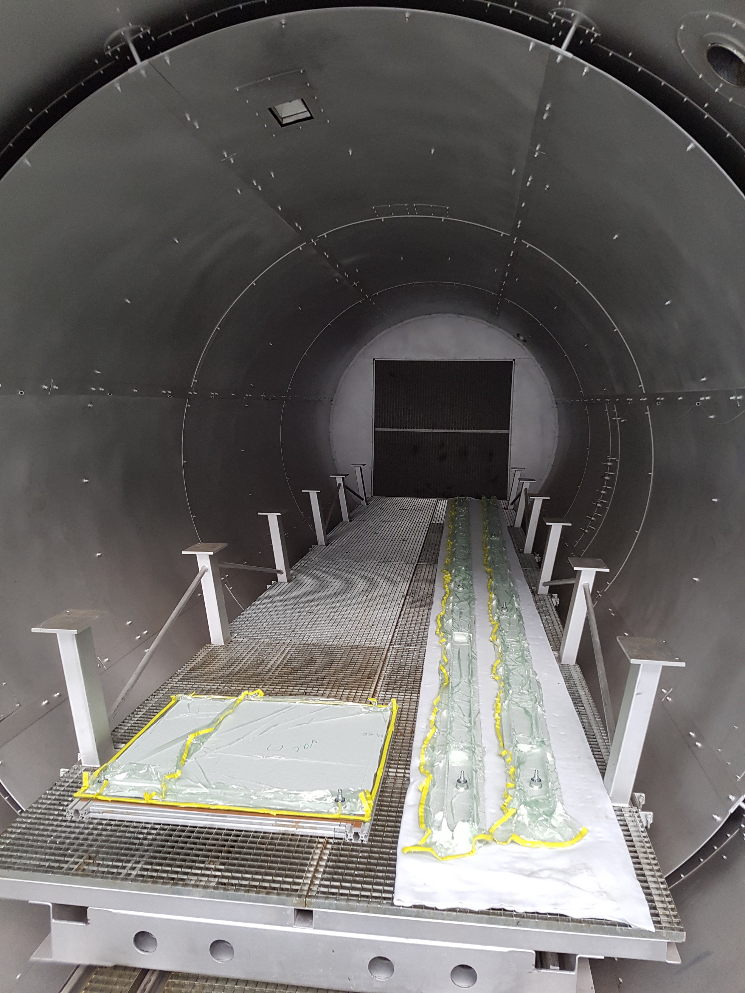 Prepreg planks and panels on the lower shelf of the large autoclave. There are two further levels with vacuum tables up to 3.3m width and 9.9m length.
