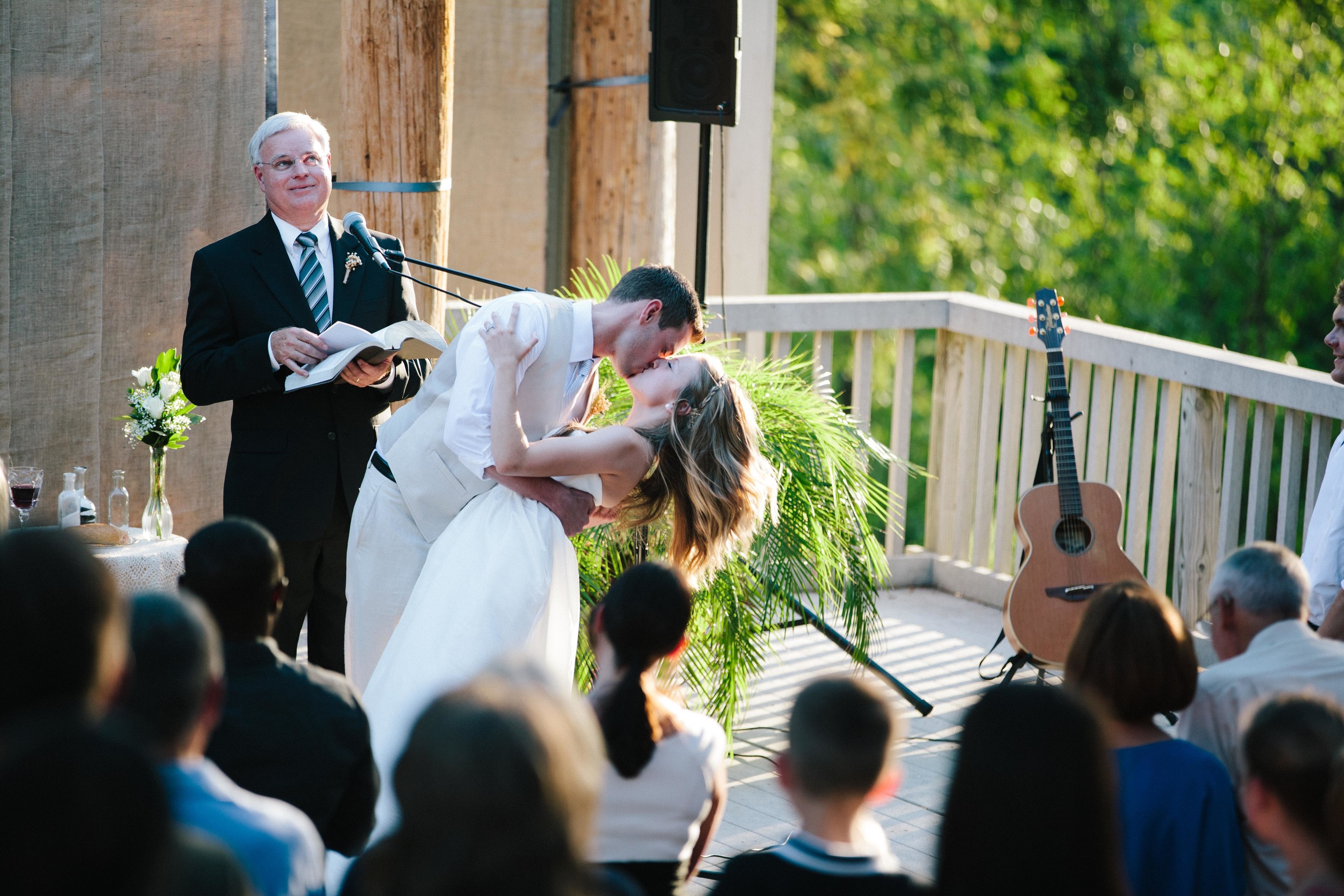 This is our first kiss as husband and wife! And that man rolling his eyes in the background is my amazing father-in-law Russ. I love both of these men so much.  Photo Credit:  Rose Wheat Photography