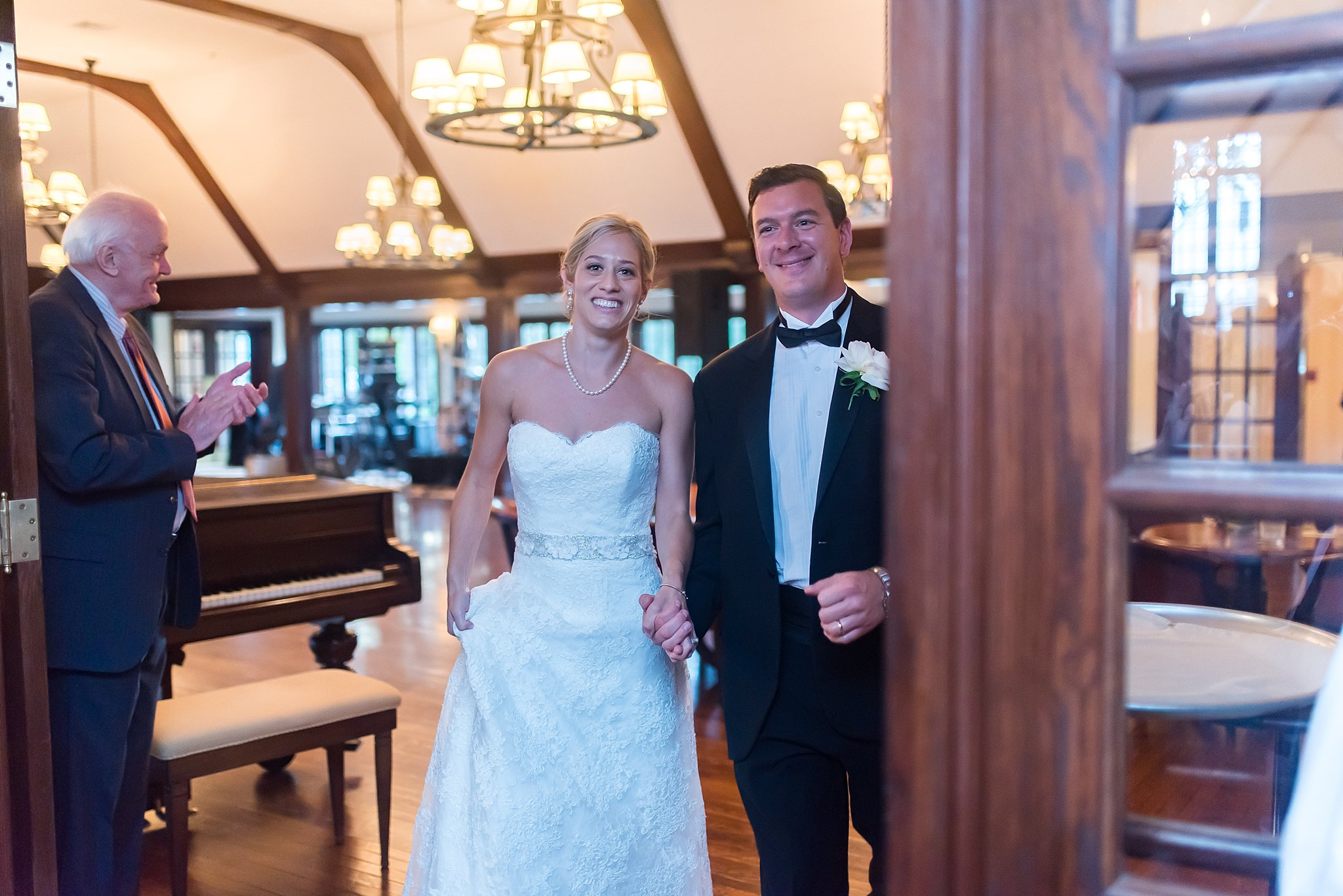 bride and groom entrance at long meadow country club.jpg