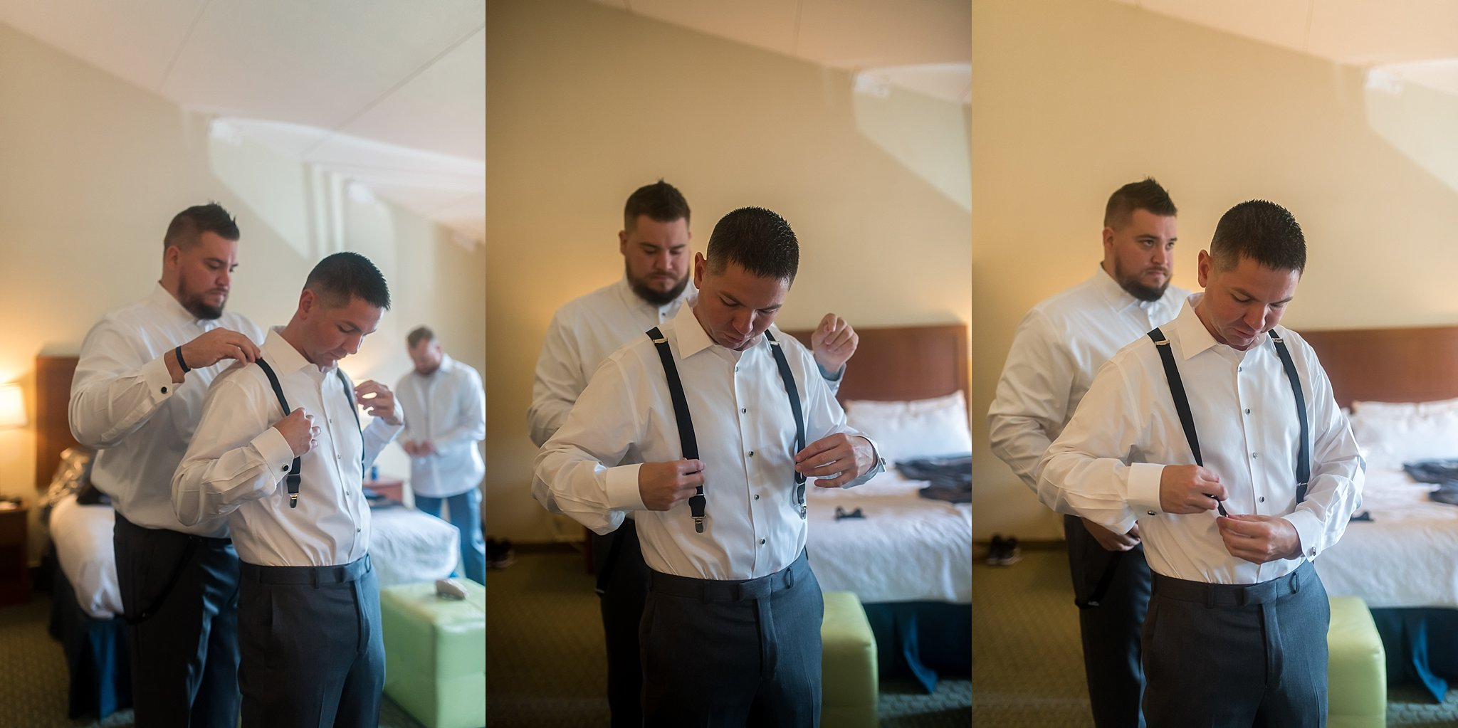 groom getting ready in holiday inn.jpg