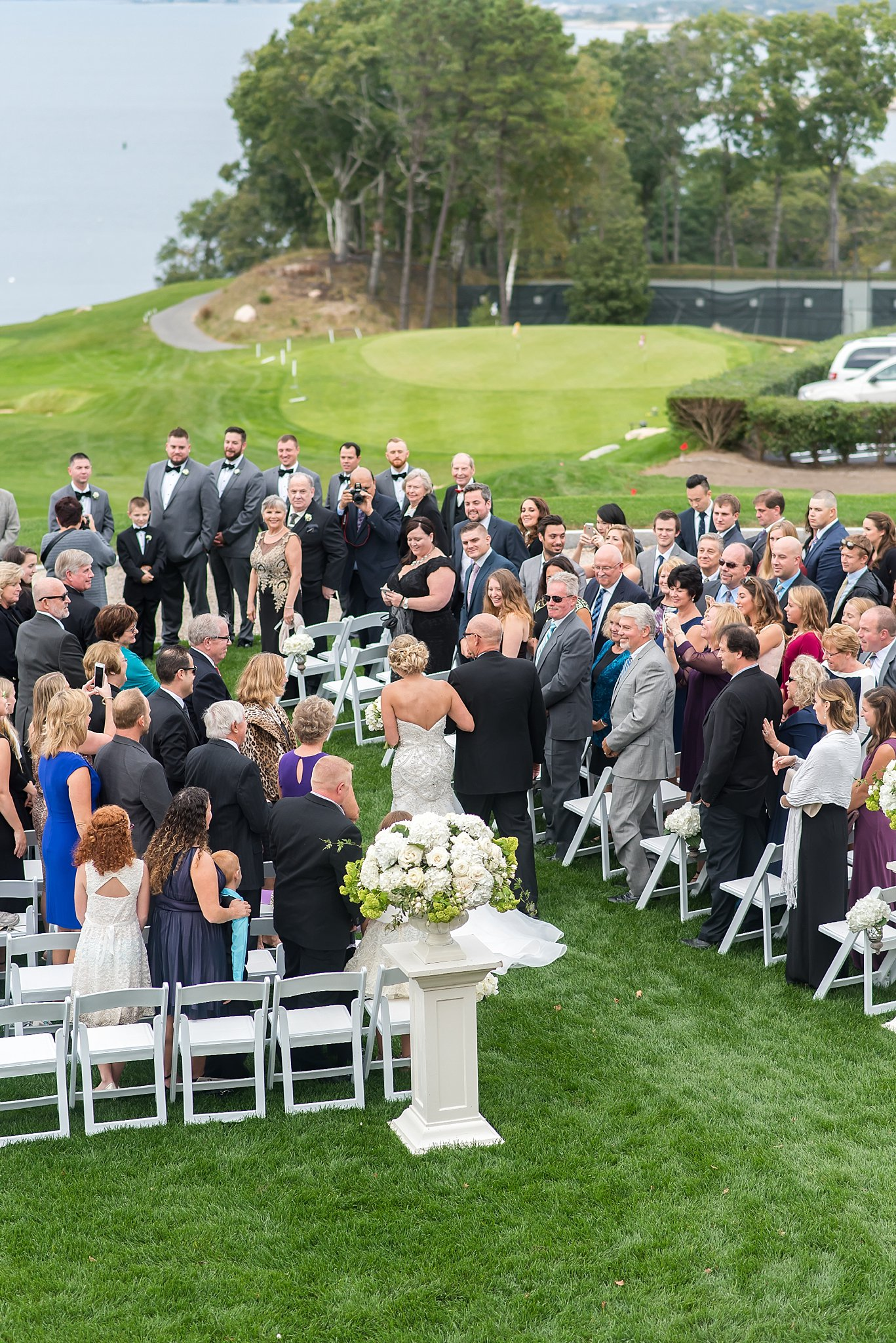 outdoor wedding ceremony at woods hole country club.jpg