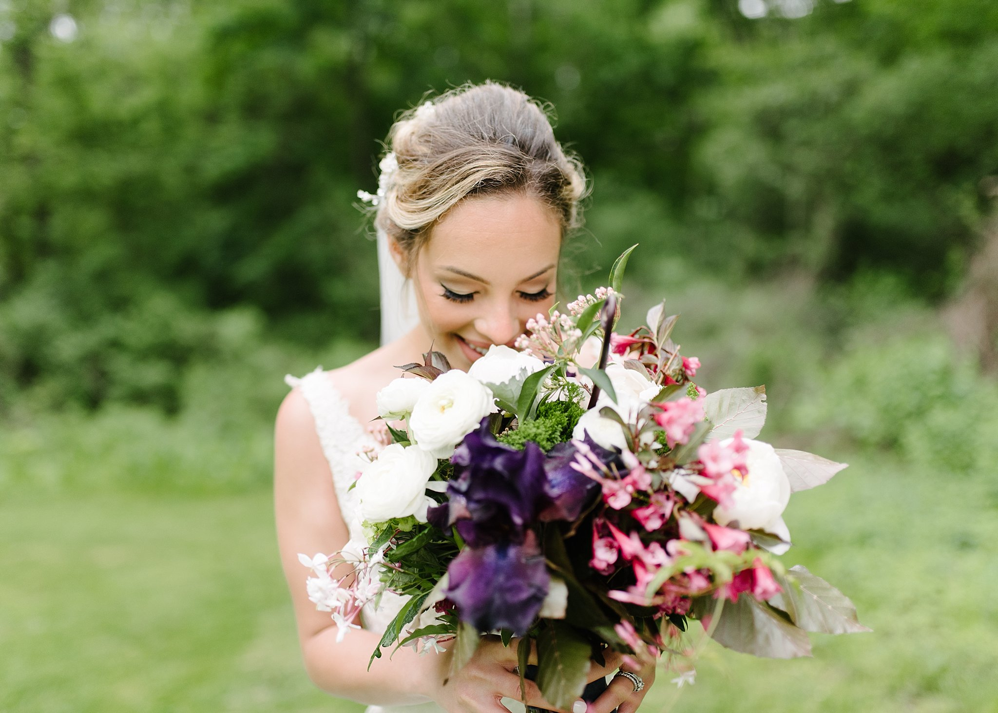 bride loving her wedding bouquet