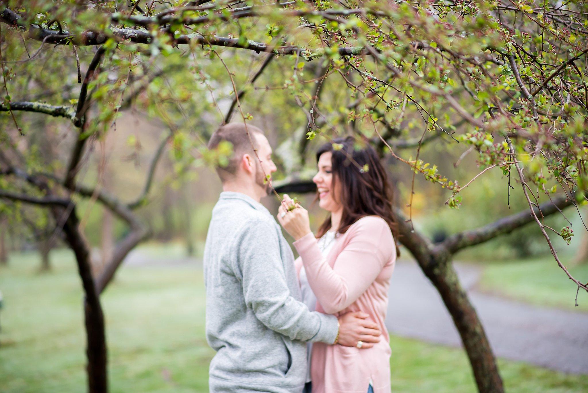 couple hugging in larz anderson park