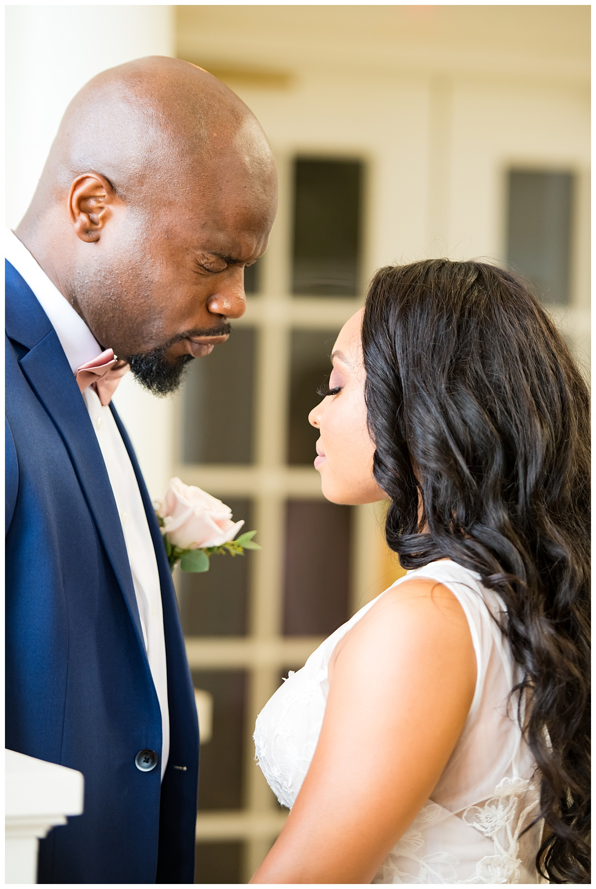 Bride and groom praying at Gordon-conwell theological seminary.jpg
