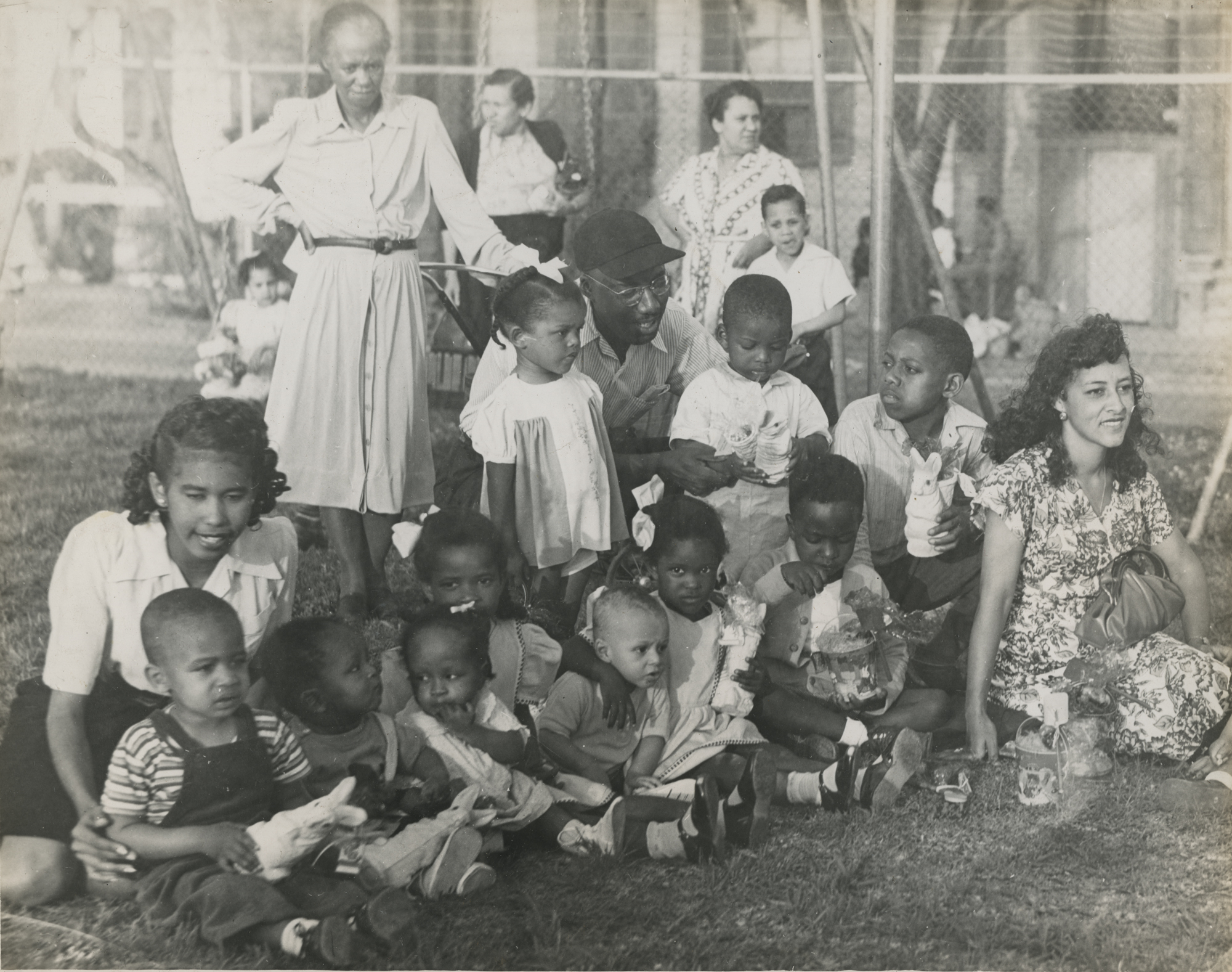 Women and children after receiving their Easter gifts. New Orleans (La.) Recreation Dept. Scrapbook photographs, 1947-1948