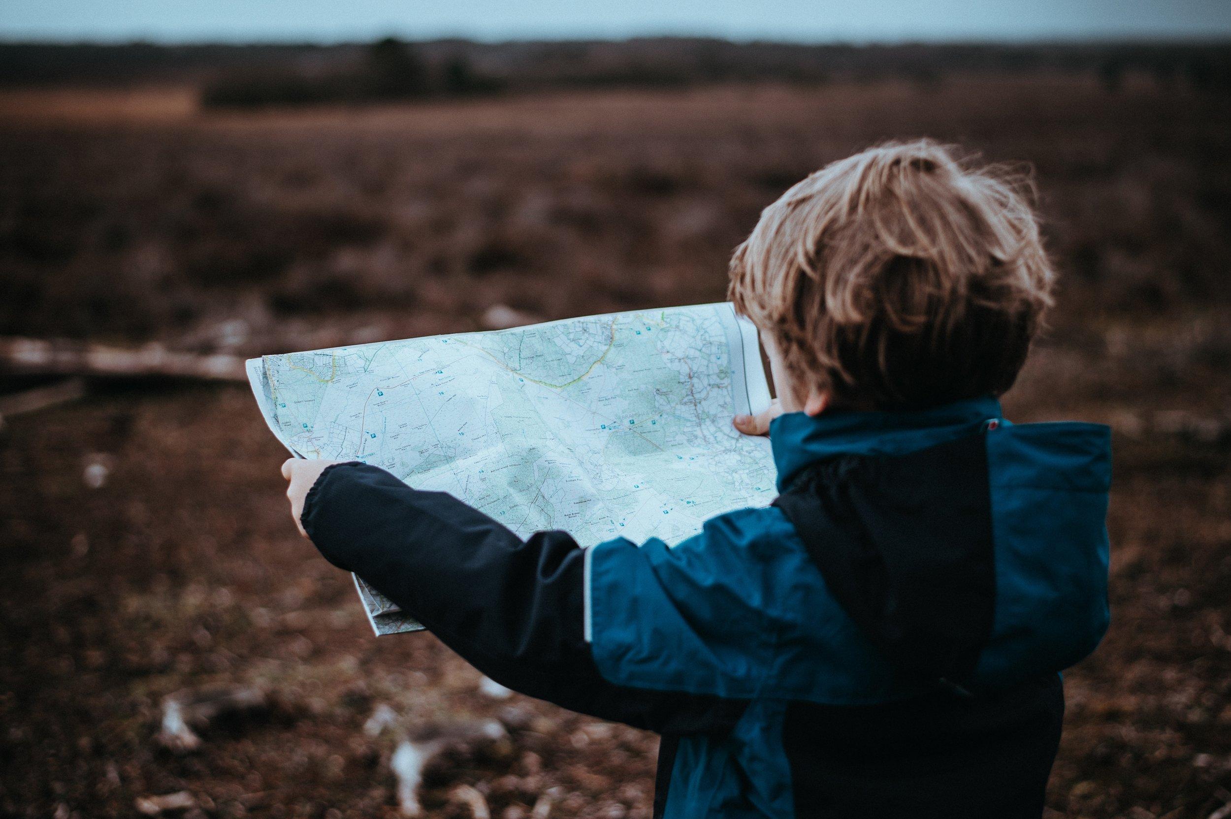 Boy holding map