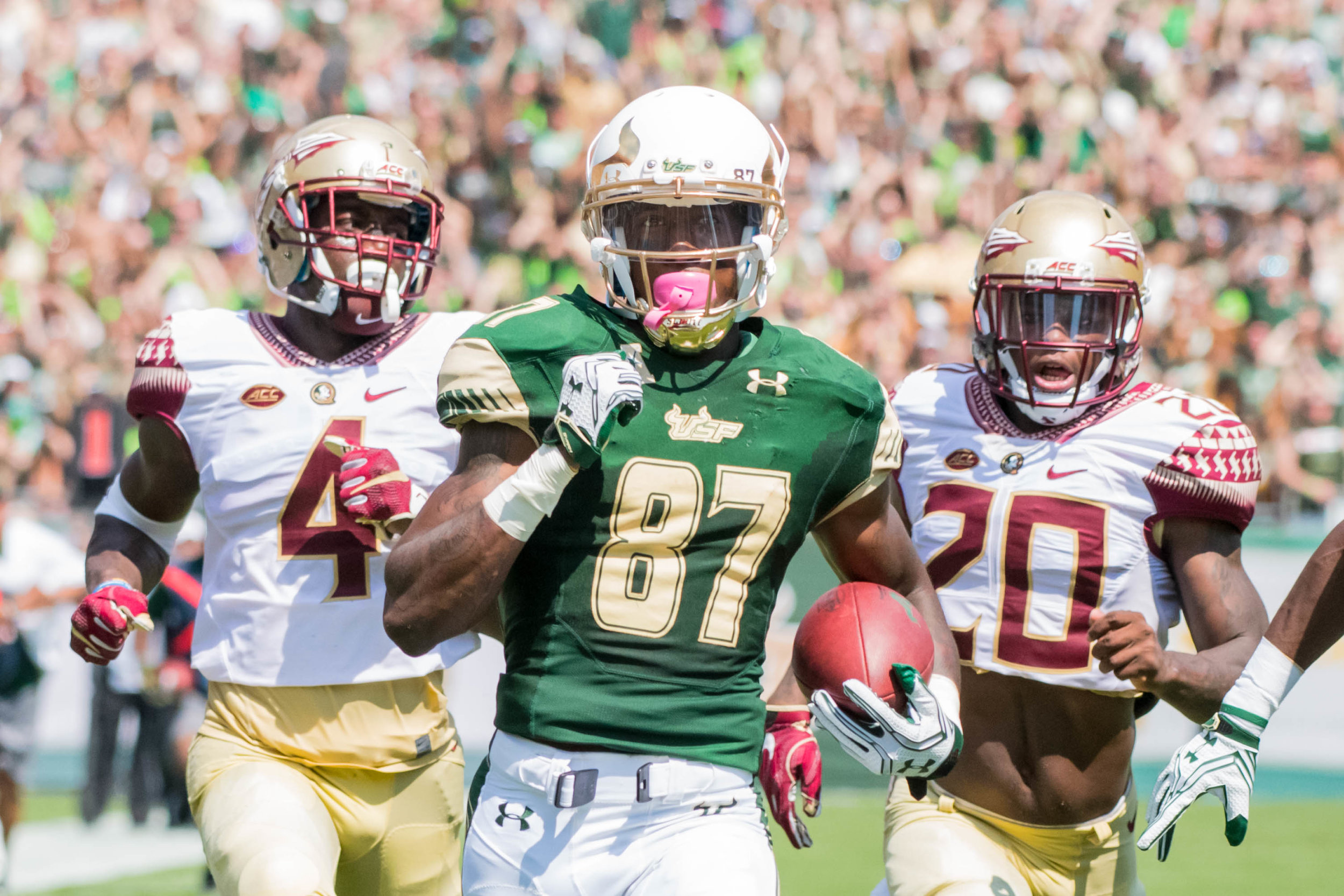 Rodney Adams as he races towards the end zone on a game opening 84-yard touchdown pass.