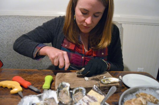 "Kate Livie, author of the new book ""Chesapeake Oysters: The Bay's Foundation and Future,"" shucks an Old Black Salt oyster at Pearl Dive Oyster Palace in Washington."