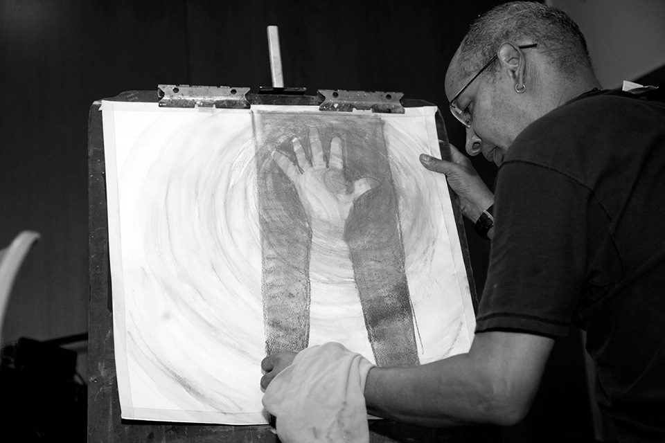Jimmy James Greene at work, photographed by legendary creative director and artist,  Hollis King.
