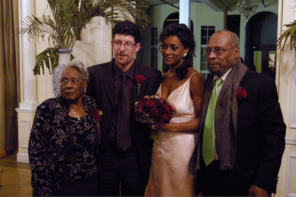 And the bride wore vintage. The stunning bride and groom surrounded by love: Aunt Bernice and Uncle Malloy.