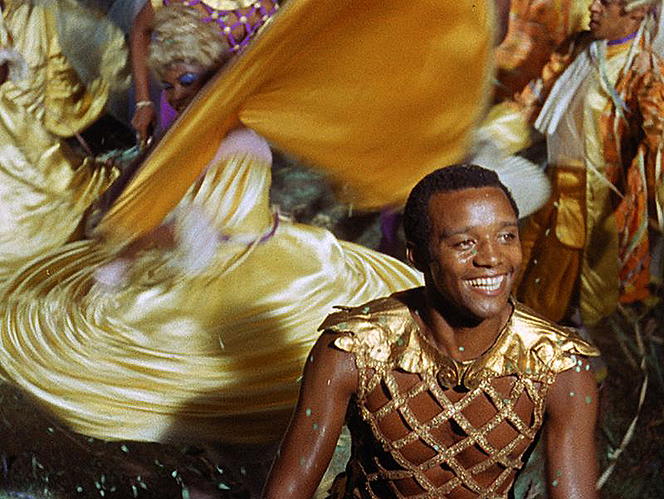 Breno Mello in the titular role of Marcel Camus'  Orfeu Negro  (Black Orpheus). The 1959 film won both the Academy Award for Best Foreign-language Film and the Cannes Film Festival's  Palme d'Or , for its glorious reimagining of the Greek mythological love story of Orpheus and Eurydice set during Carnival in Rio.