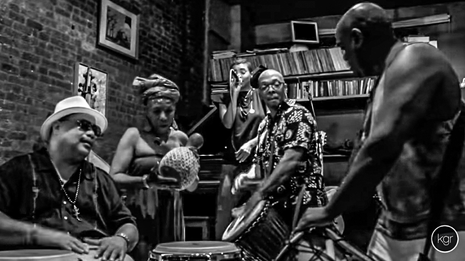 KGR hitting it with the percussionists of Afrazz: Baba Don, Lady Shekere, her bro-in-love, Ronnie Roc and Mike Wimberly. Image from the video recording of the performance.