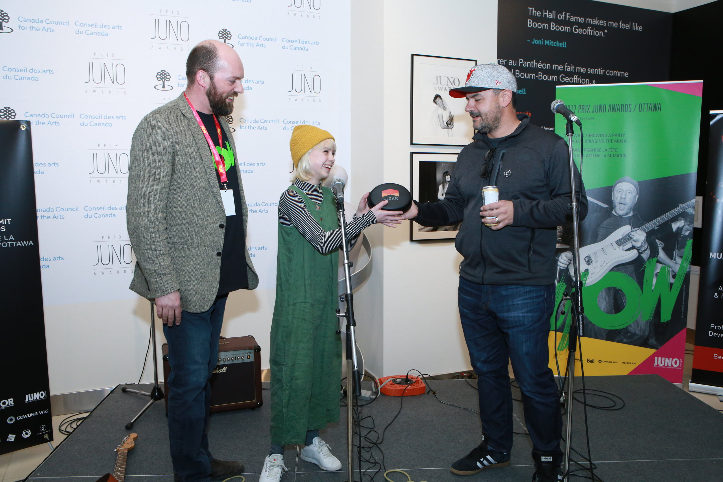 Allie O'Manique (Trails) presented with Lixar headphones by company CEO Bill Syrros and MEGAPHONO director Jon Bartlett at the Ottawa Music Summit at the Junos. (photo: John Major).