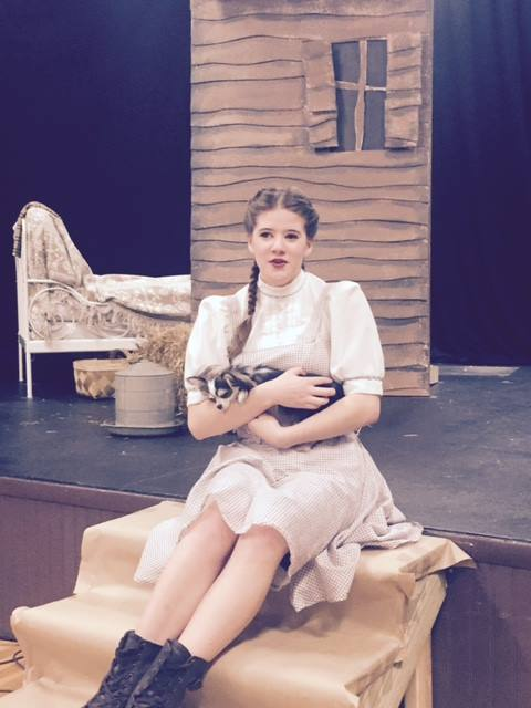 Dorothy (Charlotte Myhre) and Toto