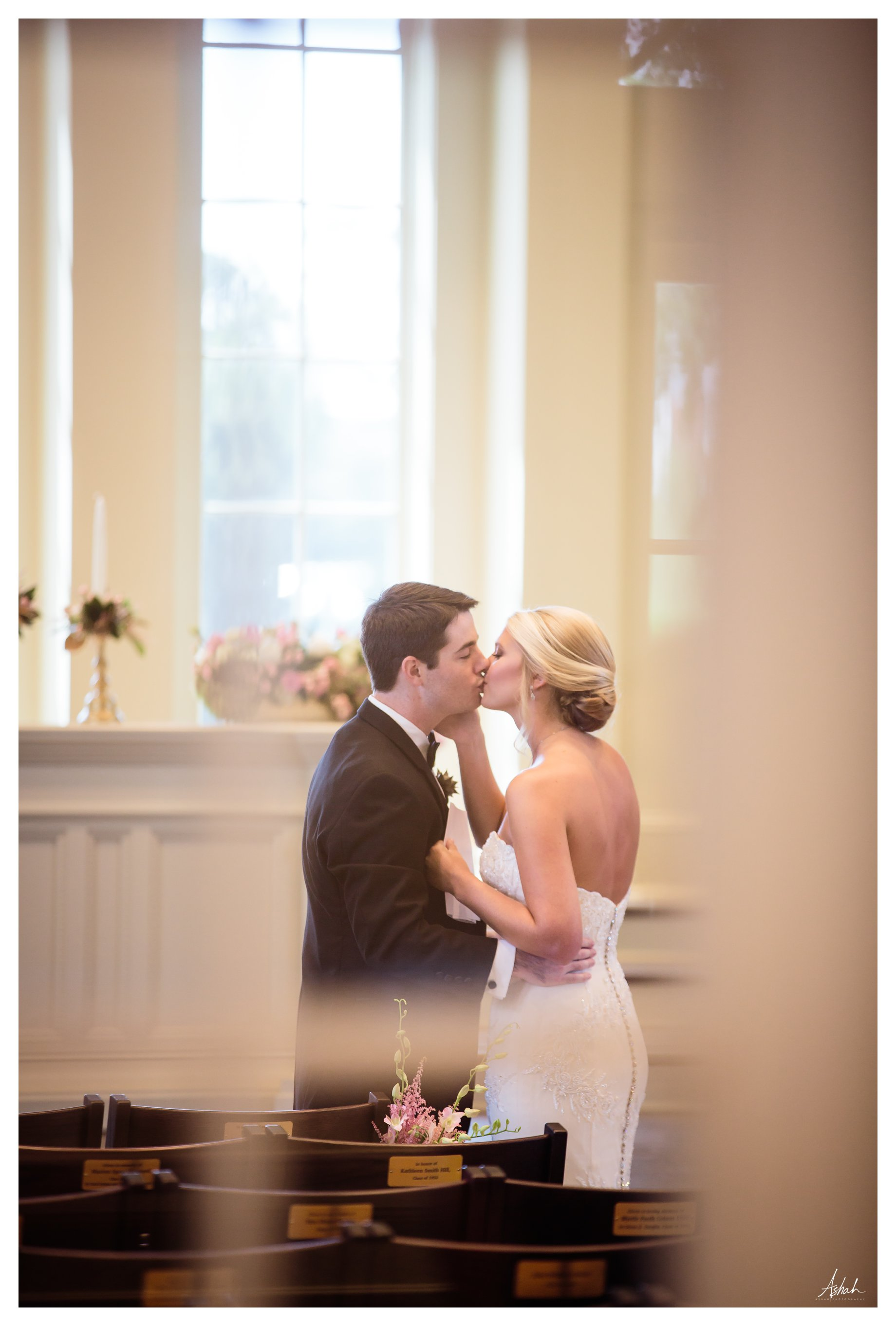 Sneaking a Kiss -- Macon Wedding Photographer
