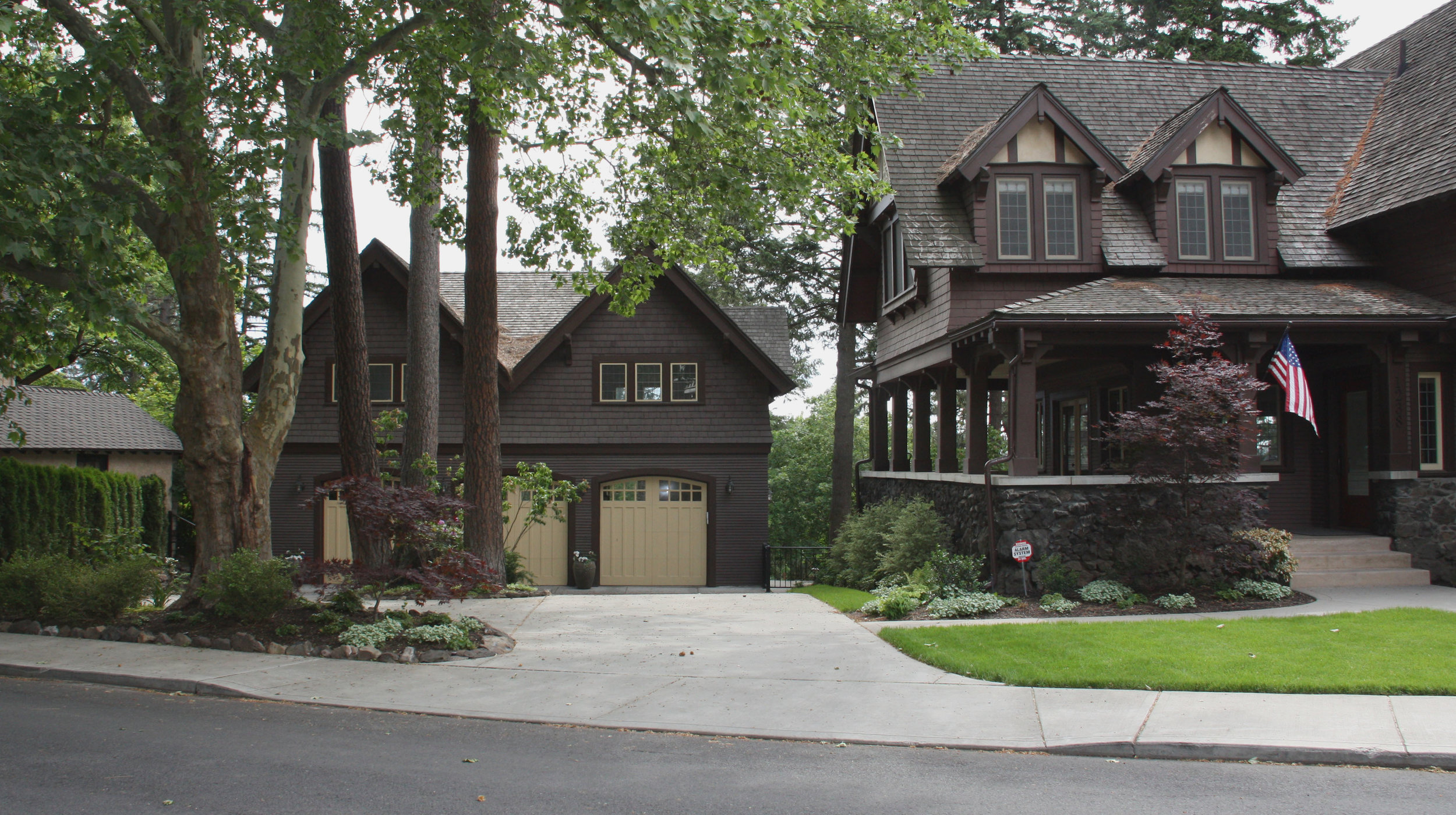 detached craftsman garage landscape