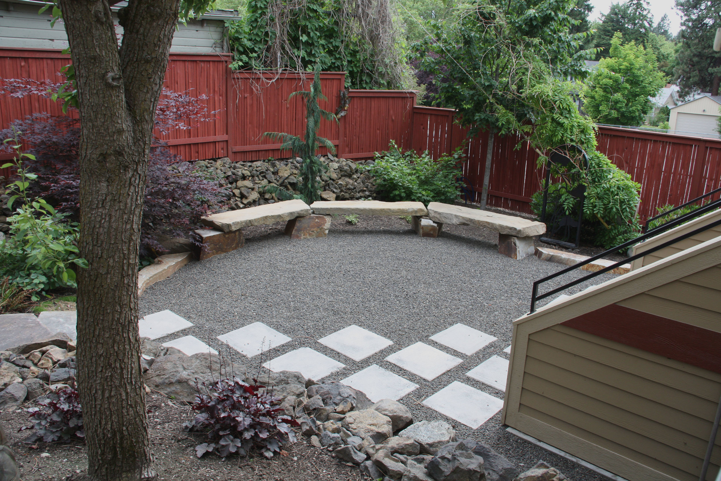 stone benches and gravel patio