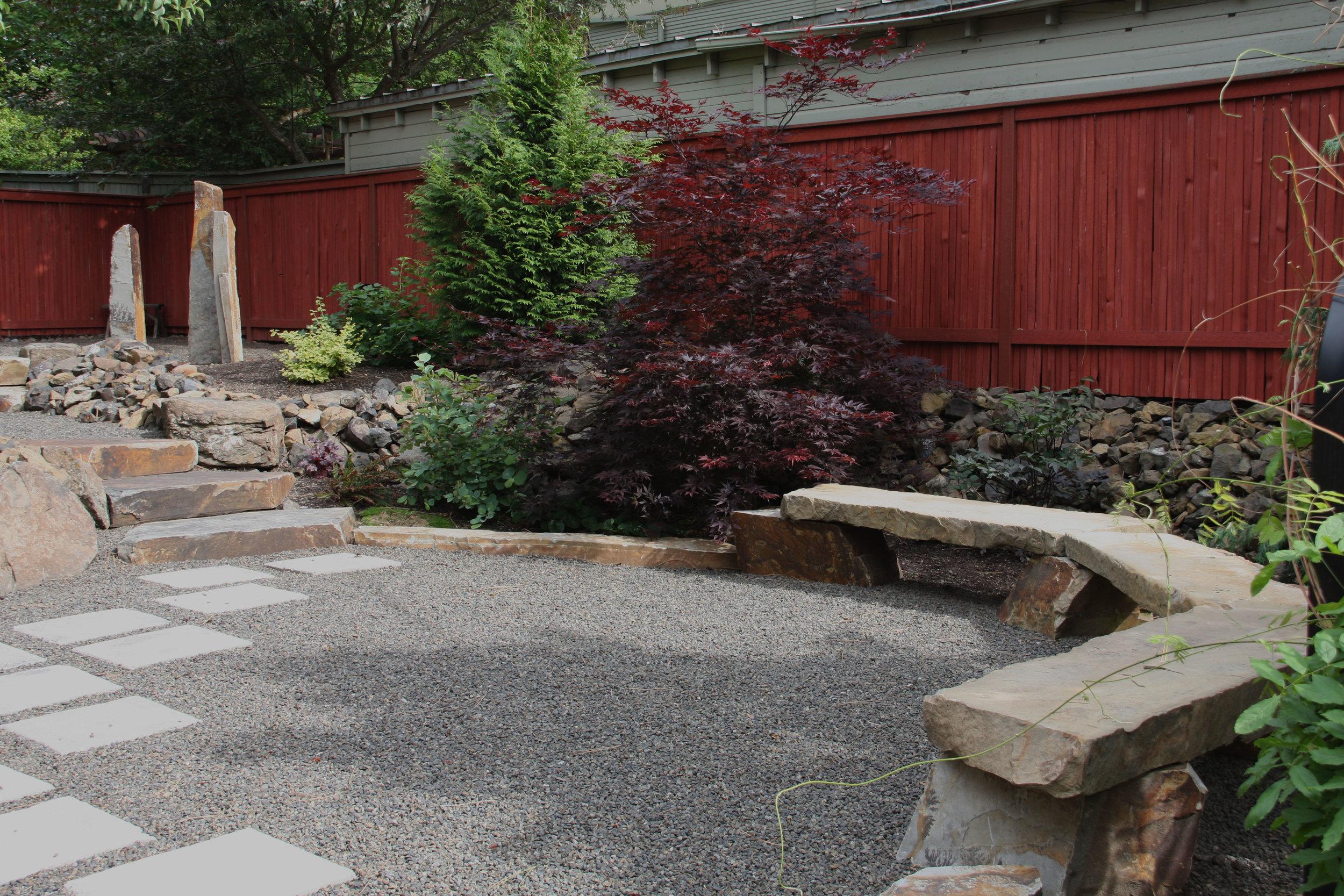 paver walkway in gravel patio