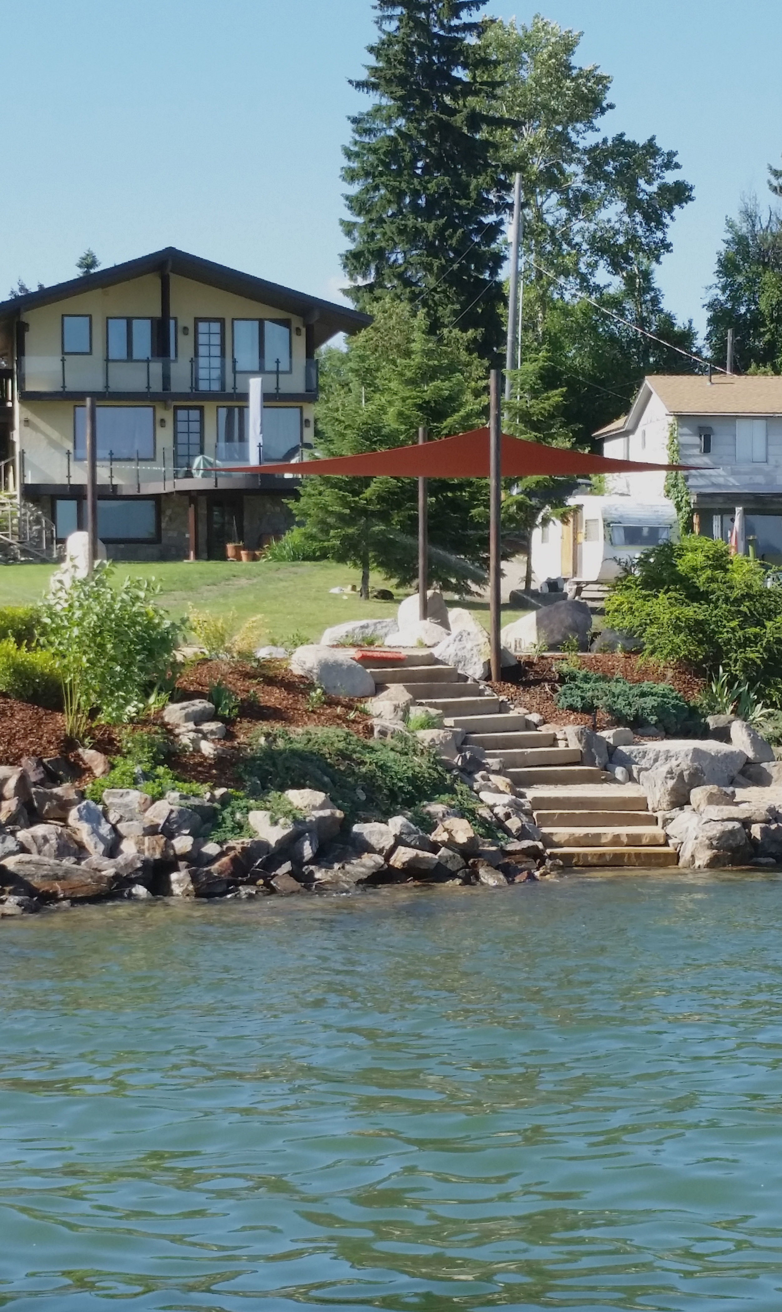 lakeside patio with shade sail