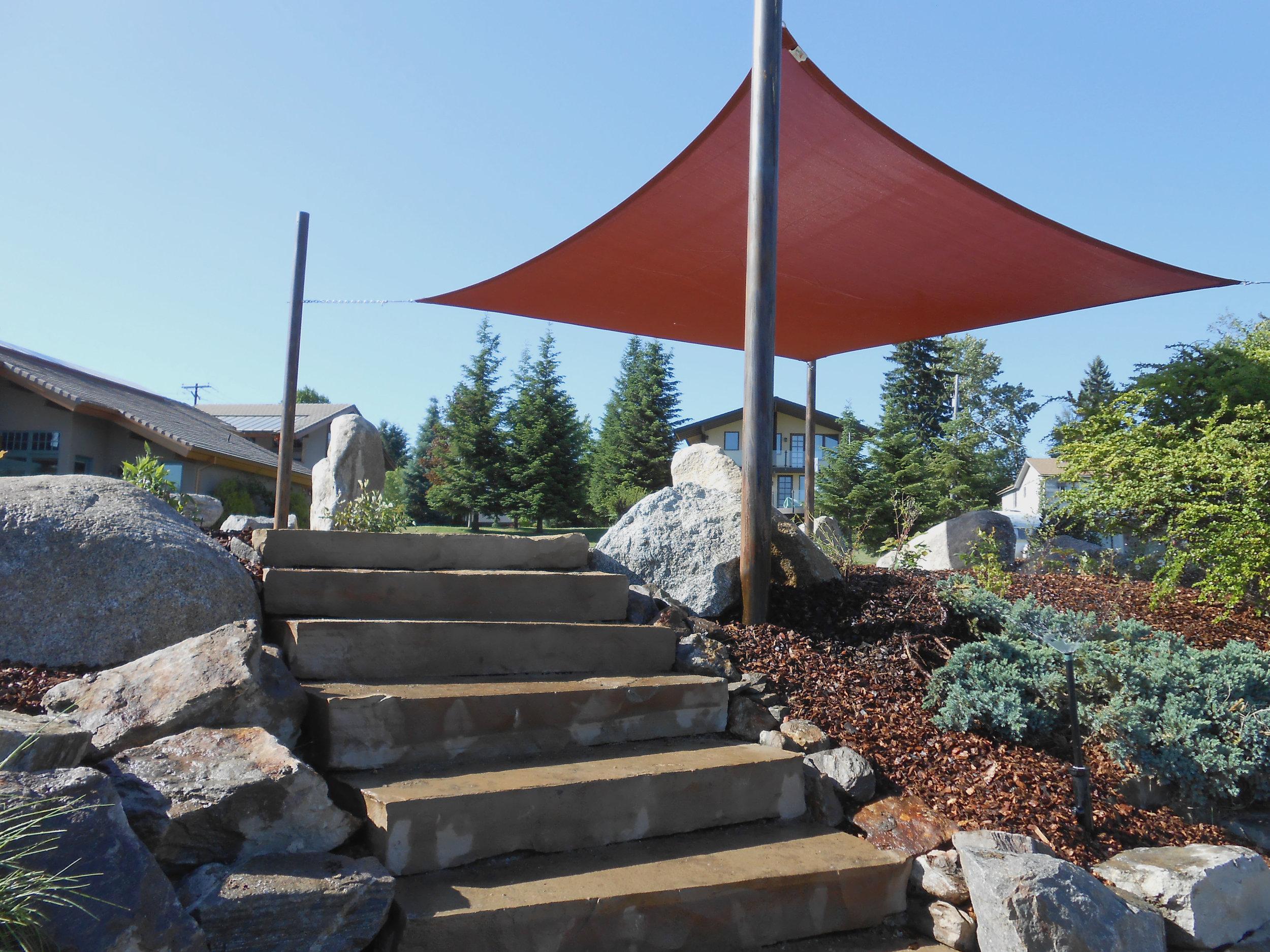 square shade sail and stone steps