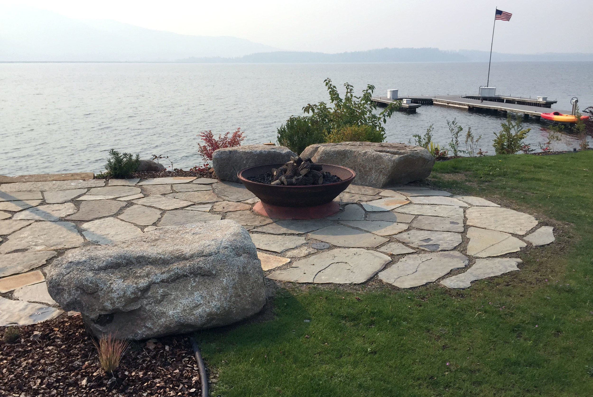 This flagstone patio creates a natural, low-impact entertaining area by the water's edge.