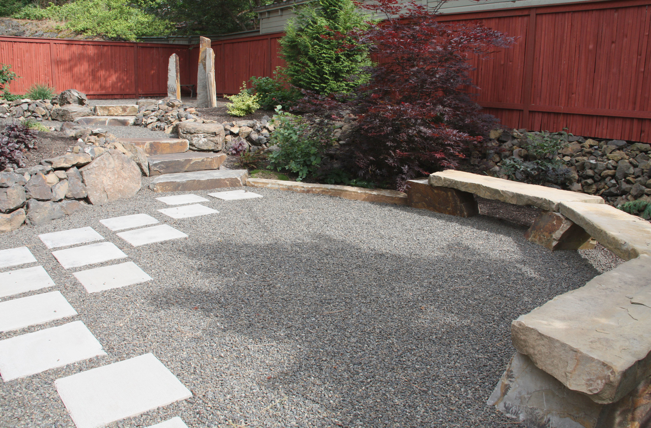 Concrete pavers set into this gravel patio create a more robust walking path.